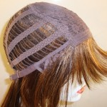 Machine wefted wig.